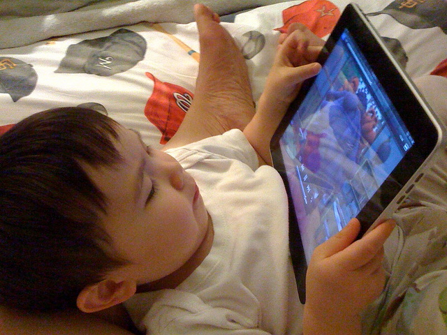 Watching iPad by Jencu via Flickr