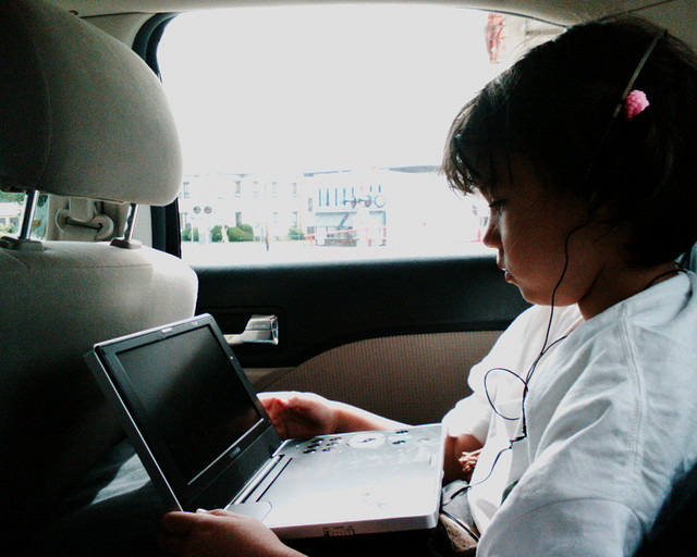 Using Laptop in Car by Eden, Janine and Jim via Flickr