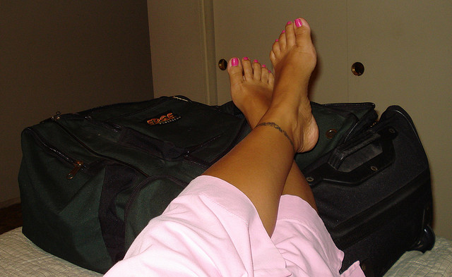 Feet on Suitcase by eyesogreen via Flickr