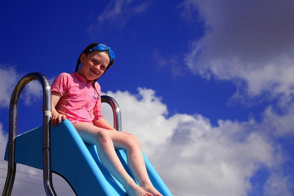 Girl on water slide by Anthony Kelly via Flickr