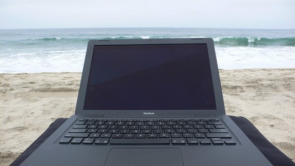 Laptop on beach by End User via Flickr